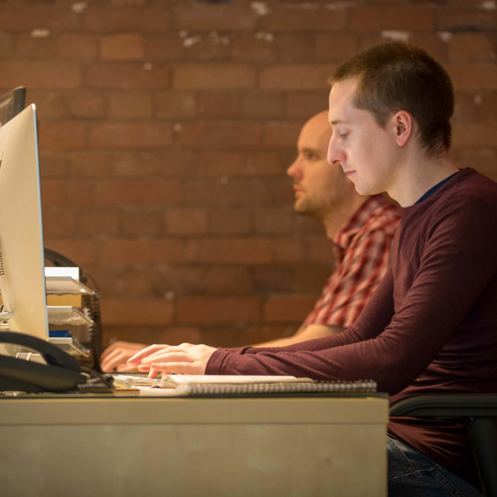 Two Web Developers Using Their Computers